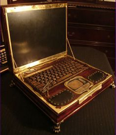 Steampunk computer!!  I found the website for this. If you want to check it out. It's for sale; handcrafted, beautiful. Not cheap, but you can look for free. :) http://www.datamancer.com/cart/datamancer-victorian-laptop-p-219.html