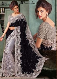 Black embroidered net and velvet saree with blouse.