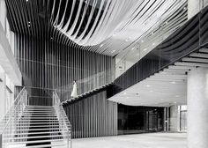 Shanghai tower by Kengo Kuma has public spaces featuring stone and aluminum panels