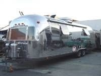 "The shape and silver color of lightweight Airstream trailers was inspired by aircraft design. The founder of Airstream, Wally Bryan, said his trailers ""cruised down the highway like a stream of ..."