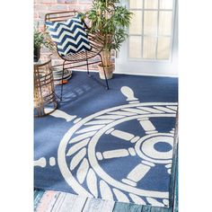 Rug with large graphic to center the room and appear less busy.