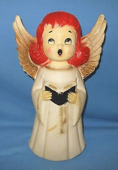 ITEM: This wonderful plastic blow mold figurine is of a choir angel. She has bright red hair and singing. Just too cute!! She is 14 high and I have added a brand new light cord. A wonderful addition