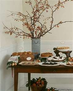 """Twigs of any kind on buffet table? White serving pieces? Old wood boxes to add height on serving table? This table setting is too """"dark and heavy"""" Just taking some elements individually."""