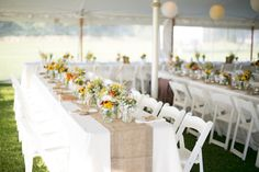 tented reception, long tables, burlap table runners, wildflowers in mason jar centerpieces, rustic beach barn wedding, Stacey Hedman Photography