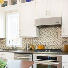 White Marble Kitchen Counter With Marble Morrocan Back Splash