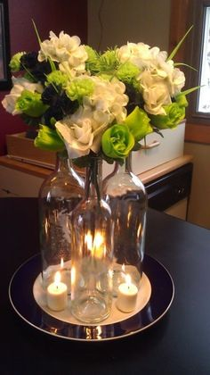 Clear glass wine bottles = DIY centerpiece!