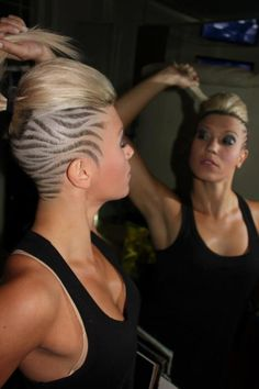 Platinum sidecut with hair tattoos
