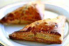 Apple Turnovers ~ Simple apple turnovers with diced tart apples, currants, walnuts, sugar and cinnamon, baked in puff pastry. ~ SimplyRecipes.com