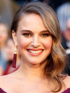 """""""This sunny, golden brown hair color really brings out the color of Natalie Portman's eyes,"""" says Robinson."""
