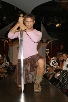 Proving that real men can wear kilts and pink at the same time.