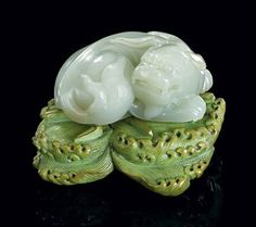 Celadon Jade Lion On A Stained Ivory Stand, Qing Dynasty, ca.18th century