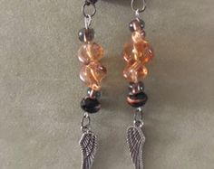 Feather charm orange black Bead Earring,charm earring,drop earring,dangle earring,feather earring, motorcycle earring,vintage earring by dawnsbeadsdesigns. Explore more products on http://dawnsbeadsdesigns.etsy.com