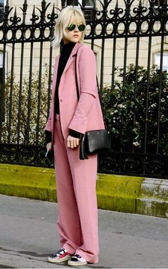 A lesson in wide leg trousers: Fashion editor Linda Tol wears a flat shoe to ensure her hems hit the floor.