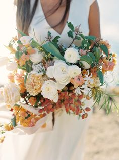 Photography: Cassidy Carson - cassidycarsonphotography.com Floral Design: Kelly Lenard - www.kellylenard.com Read More on SMP: http://www.stylemepretty.com/2016/01/08/california-cliffside-elopement-inspiration/
