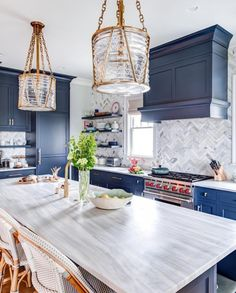 You have to see these blue kitchen cabinets with herringbone walls. Love it! #KitchenDesign #HomeDecorIdeas @istandarddesign