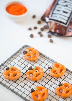 Chocolate Covered Pretzel Pumpkins – a quick, easy, and delicious fall snack! Three ingredients and 10 minutes is all you need to make these adorable pretzel pumpkins!