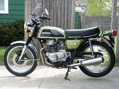 1974 Honda CB200.  My first scoot.  In orange.