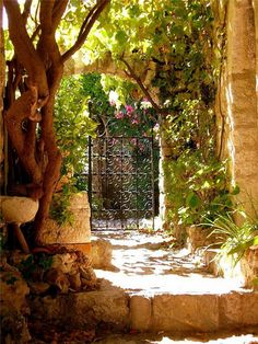 Old-World Welcome - A heavy, beautiful gate, perhaps with a little squeak to it, always reminds us of The Secret Garden.