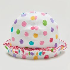 An adorable colourful hat for baby girls by Kissy Kissy. Made with 100% soft Peruvian pima cotton for softness and comfort. Colourful polka dots. Fuschia embroidered trim. Perfect for protecting baby's delicate head on sunny days. Complete the look with matching items from Kissy Kissy's Pique Bears collection.