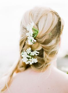 With flowers in her hair. Photography : Lance Nicoll Wedding Photography Read More on SMP: http://www.stylemepretty.com/mississippi-weddings/biloxi/2016/08/05/ethereal-southeast-beach-wedding-inspiration/