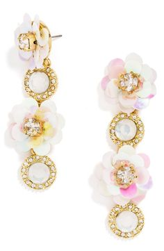 Spring is in full bloom with these earrings from BaubleBar. Iridescent flowers centered with sparkling crystals radiate an ultra-feminine vibe.