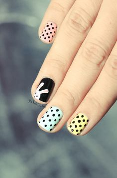 Easter pastel nail art. I like it, but I wouldn't do the bunny. I would just paint it black.