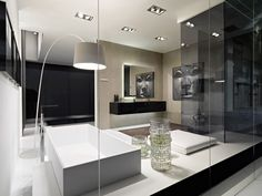 Kubik - Inside the area, furniture in ebony veneer glossy finish, bathtub mod. Bridge with integrated lighting, white matt lacquered patform, shower tray mod. Line.