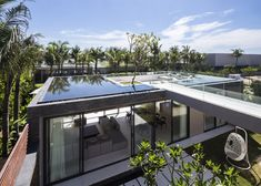 Vietnamese villa with rooftop pools that surround a series of sunken lounges