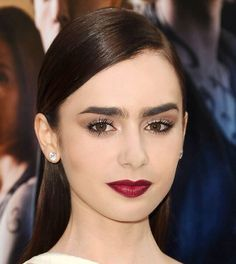 Dark features-Oxblood lips and think bushy brows perfection.