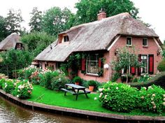 Pretty English country thatched roof cottage.