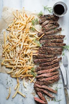 Easy grilled skirt steak served with Parmesan truffle french fries. Get the recipe and see my favorite wine pairing for this dish too!