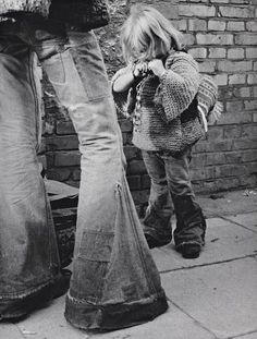 Those jeans! I would totally rock them today! and that kid... awww little hippie kid <3