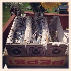 Anniversary party: Sewing drawers doilies and soda crate...love it!