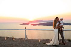 I had to share a photo from my good friend's destination wedding in Santorini, Greece!!  I adore this candid moment of the happy family with little handsome Jack, his father Jamie, and his mom Hannah. Can't get enough of sunset photos - especially while overlooking their reception venue in Greece with romantic candles lit. The turquoise water and the mountains is just so beyond words.