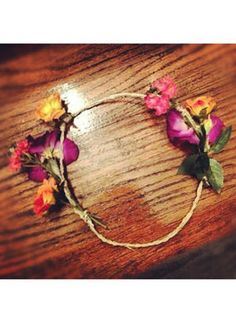 1. buy a bunch of faux flowers keeping with one color pattern or theme. 2. get fabric glue and yard of craft wire 3. Cut the wire or rope bigger than the circle you'd like to have on your head. If you choose the wire, wrap a thin ribbon all around it and tie it at the end in a knot. 4. Pick the flower buds off the stems and glue the buds and a few leaves wherever you'd like.