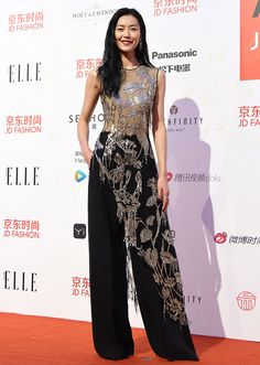 STYLECASTER | 17 Celebrities Who Wore A Dress Over Pants | Liu Wen
