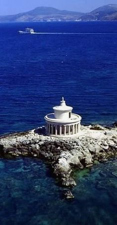 Argostoli, Greece. See the northern landscapes and traditional villages whose historic Venetian architecture, including the Saint Theodoroi lighthouse, miraculously survived the earthquake of 1953.