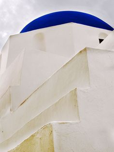 White churche with bkue dome in Ios island.