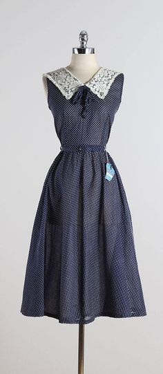➳ vintage 1950s dress * deep navy blue semi sheer Velveray processed fabric * white double swiss dots * metal back zipper * lace collar * original belt * never worn with original tags and washing instructions * from Daytons condition   excellent fits like m/l length 46 bodice length 17 bust 38 waist 29 some clothes may be clipped on dress form to show best fit for appropriate size. ➳ shop http://www.etsy.com/shop/millstreetvintage?ref=si_shop ➳ shop polici...