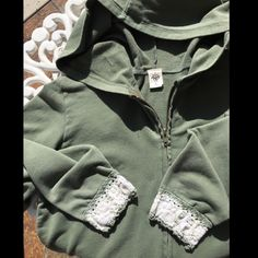 Green With White Cuff Hoodie Green hoodie with white & green knit cuffs at end of sleeves. Cuffs are a cute addition to this simple hoodie.  Normal wear for a preloved garment. 95% Cotton & 5% Spandex. prAna Tops Sweatshirts & Hoodies