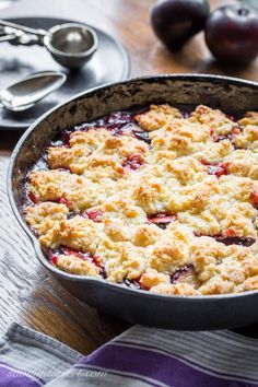 Easy Plum Cobbler - sliced fresh plums topped with a sweet crumbled dough, cobbled together for a quick and easy dessert featuring these delicious juicy fruits. www.savingdessert.com