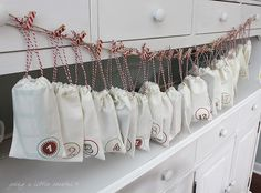Christmas Advent Calender with White small bags and surprises inside!