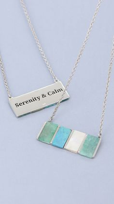 """This necklace's stones are specifically chosen for their calming qualities for when you are looking to quiet the mind and quell your worries. Calming turquoise teams up with quaint amazonite and serene mother of pearl, adding a pop of color along with its soothing properties. Set in sterling silver on a simple link chain. Features """"Serenity & Calm"""" as your personal mantra on the back. Stone Necklace, Arrow Necklace, Pendant Necklace, Personal Mantra, Healing Gemstones, Sterling Necklaces, Calming, Serenity, Color Pop"""