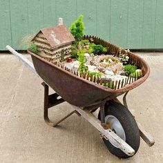 Create a charming little landscape in a vintage wheelbarrow that you can move about to suit your mood or lifestyle. We show you how to make a fairy garden, including how to select fairy garden plants, fairy garden accessories/ Fairy Garden Plants, Mini Fairy Garden, Garden Terrarium, Fairy Garden Houses, Gnome Garden, Herb Garden, Fairy Pots, Moss Garden, Big Garden
