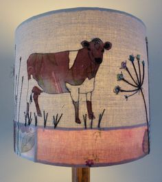 Friesian Cow embroidered lampshade measuring 30cm x 25cm.  http://www.johilltextiles.co.uk/lampshades