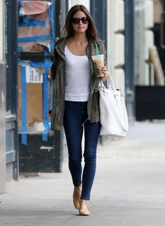 Green utility jacket, white t shirt, dark skinny jeans, nude flats