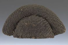 Ceremonial hat Bamun or Bamileke people Cameroon  20th century Basketry strcture with superimposed crochet patterning 21 cm x 39 cm wide