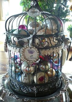 Fill a bird cage with ornaments