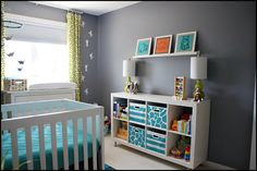 Gray nursery with pops of color of green and aqua