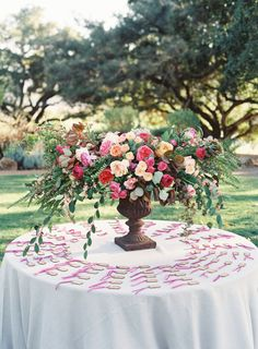 Colorful garden rose centerpiece; http://www.stylemepretty.com/2016/05/26/colorful-kunde-ruins-california-wedding/ | Photography: Emily Scott - http://emily-scott.co/